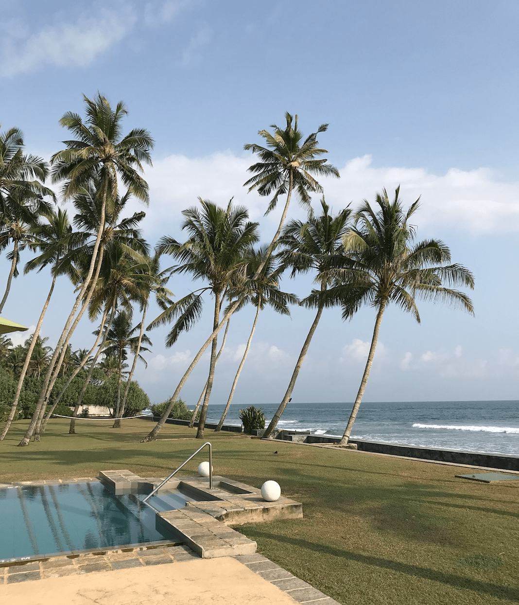 View of pool, garden and beach at Tanamera Estate near Galle in Sri Lanka