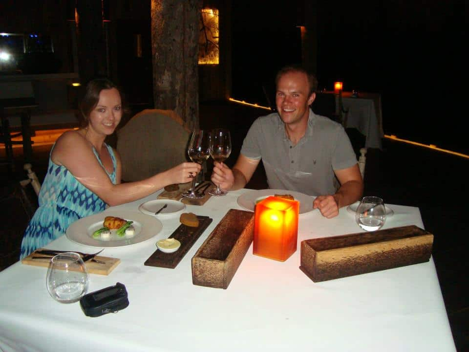 Travellers at Song Saa having dinner with a class of wine
