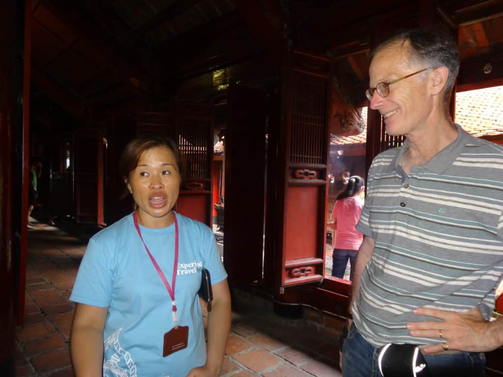 Sir John Ramsden with Experience Travel guide Ms Oanh visiting the Temple of Literature in Hanoi.