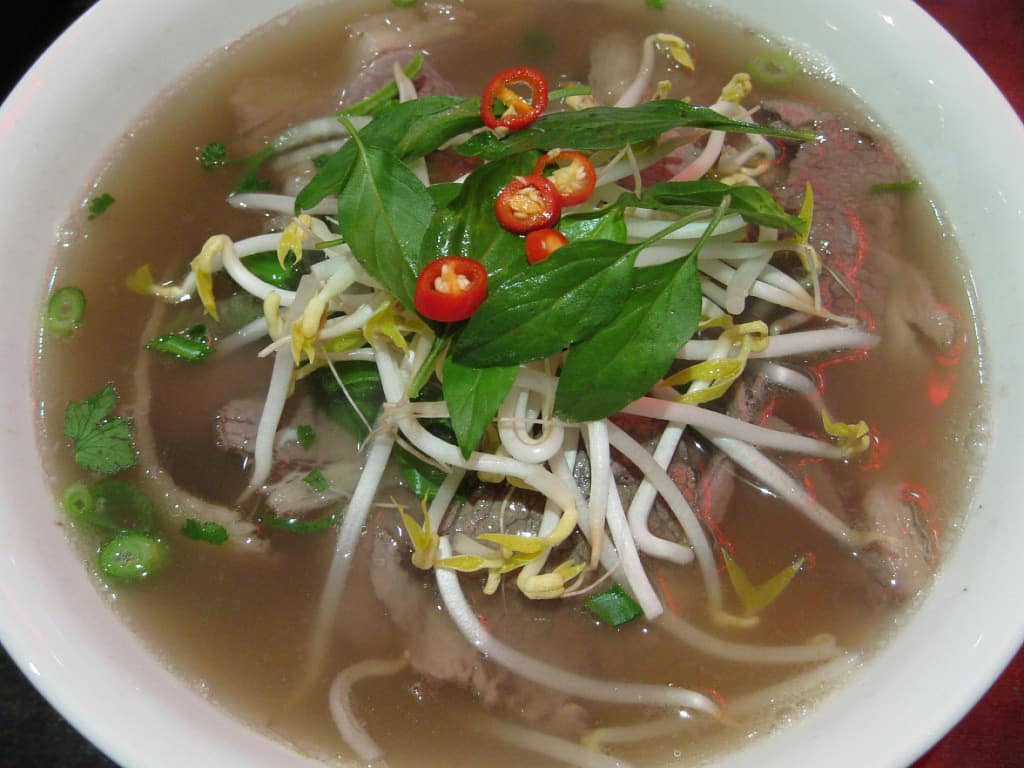 Vietnamese phở noodle soup with thinly sliced beef and beef brisket. Kham Tran