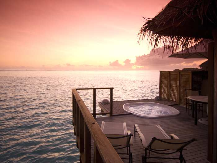 Sunset view from an over water villa in the Maldives