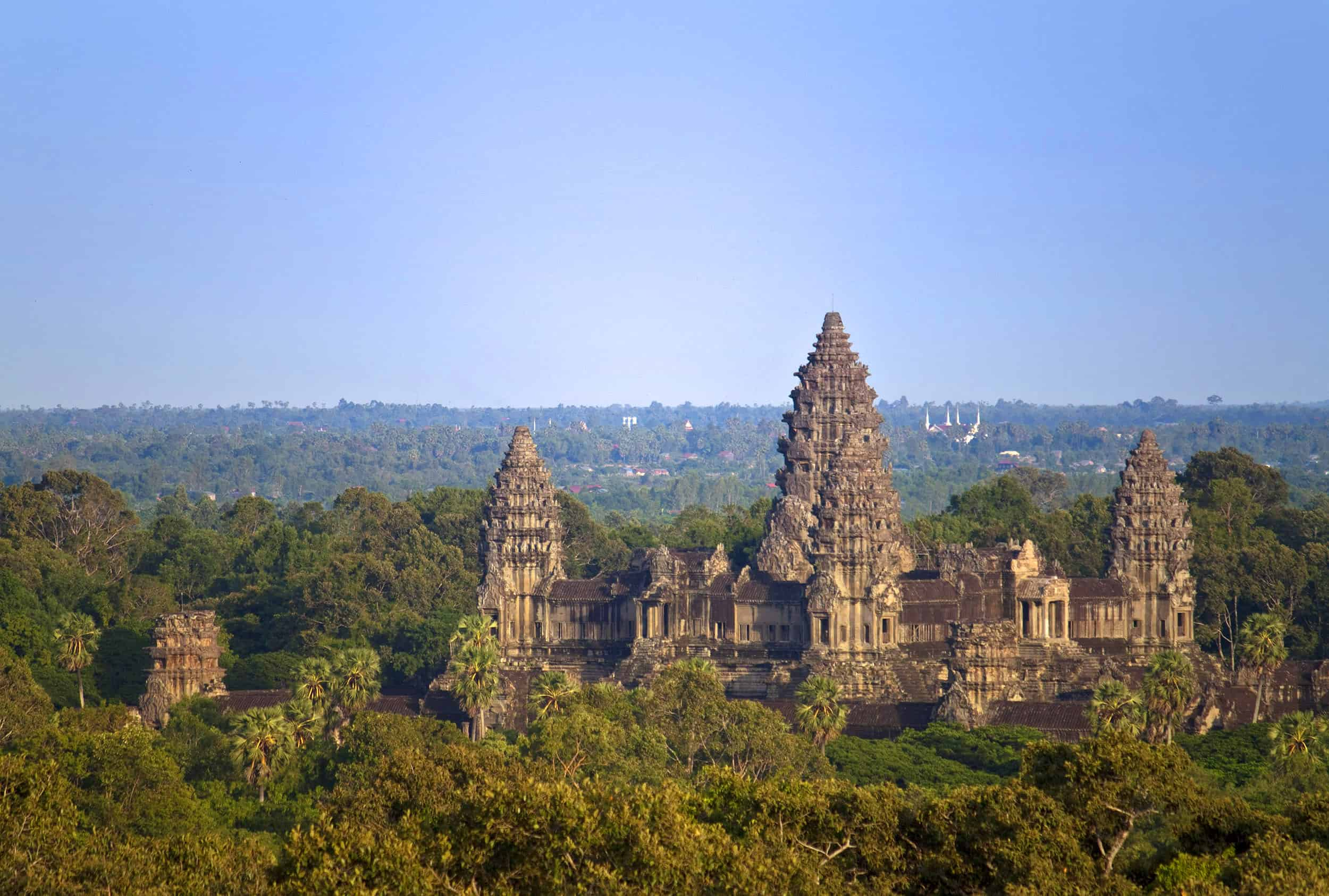 Angkor Wat Temple in Cambodia from a far above the jungle canopy