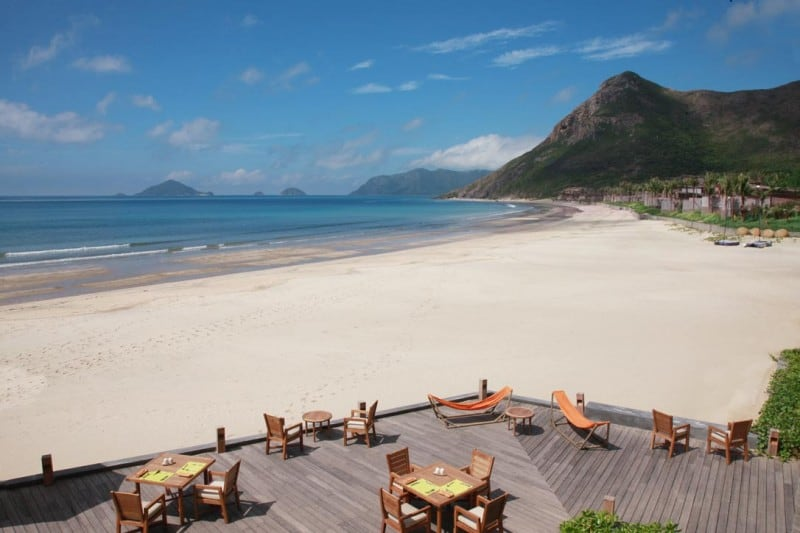 The beach at Six Senses Con Dao with a mountain in the background