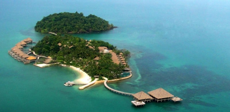 Song Saa private island resort from above with coral under the ocean
