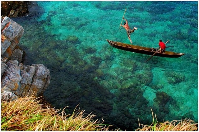 Fisherman in the Mergui Archipelago diving into the sea from their small boat