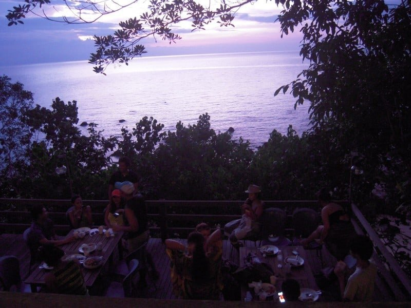 travellers eating at the restaurant of Permai Rainforest Resort which overlooks the ocean