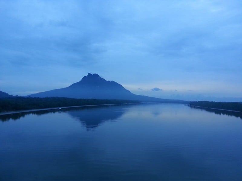 Mount Santubong at sunrise across the estuary