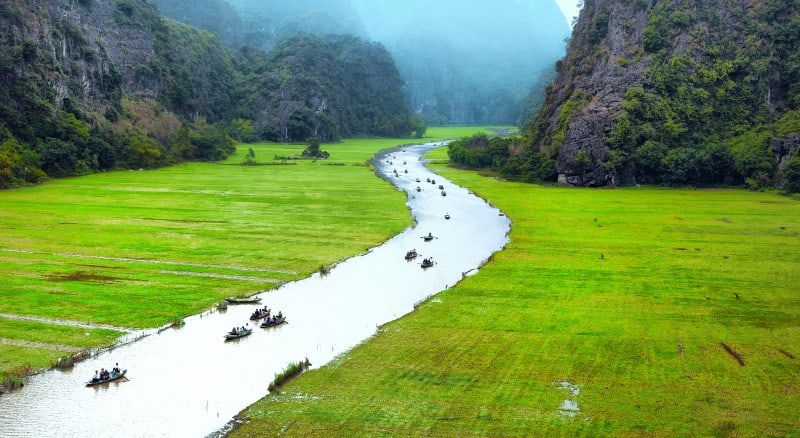 Vietnam travel landscape. Twisted river and mountains of Tam Coc Ninh Binh