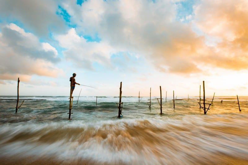 Stilt fisherman off the south coast of Sri Lanka near Koggala
