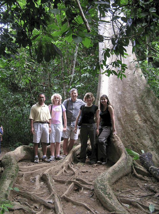 A family in Taman Negara in Malaysia under a huge tree