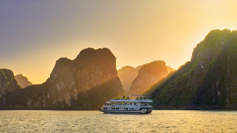 Dreamy sunset among the rocks of Halong Bay, Vietnam