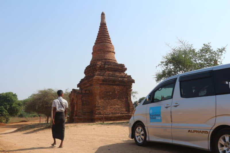 Guide close to the temples of Bagan with an Experience Travel group vehicle