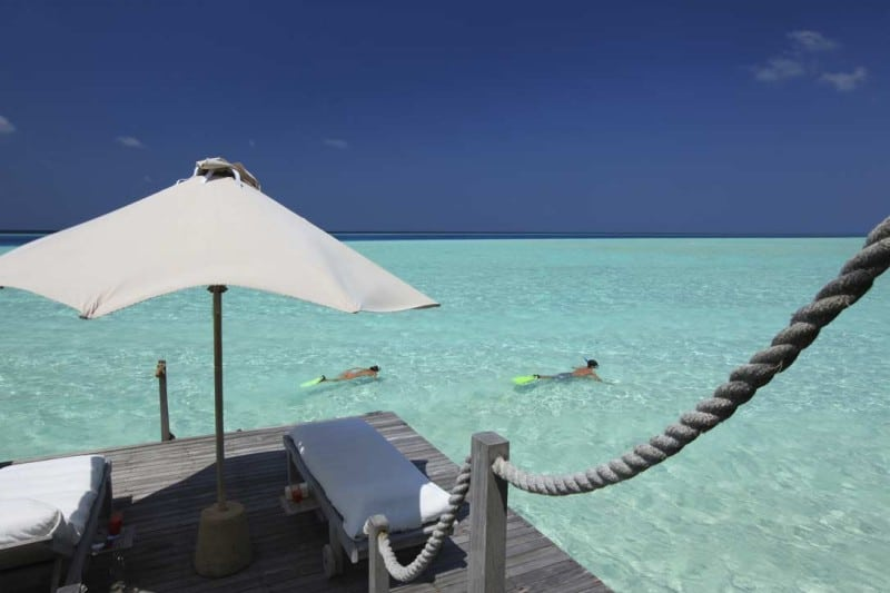 Snorkeling from the deck of your private over water villa in the Maldives