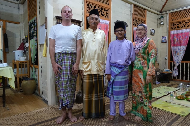 Traveller with Malay family dressed in traditional clothes