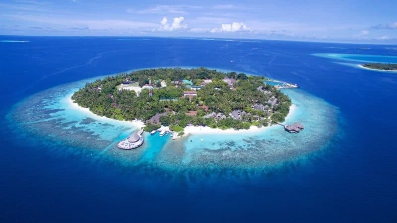 Bandos island from above with beautiful coral surrounding the island