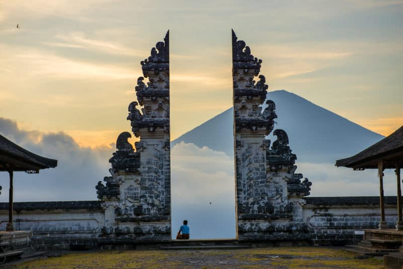 View over one of the lesser-known temples in Indonesia with a view over the mountains in a far distance