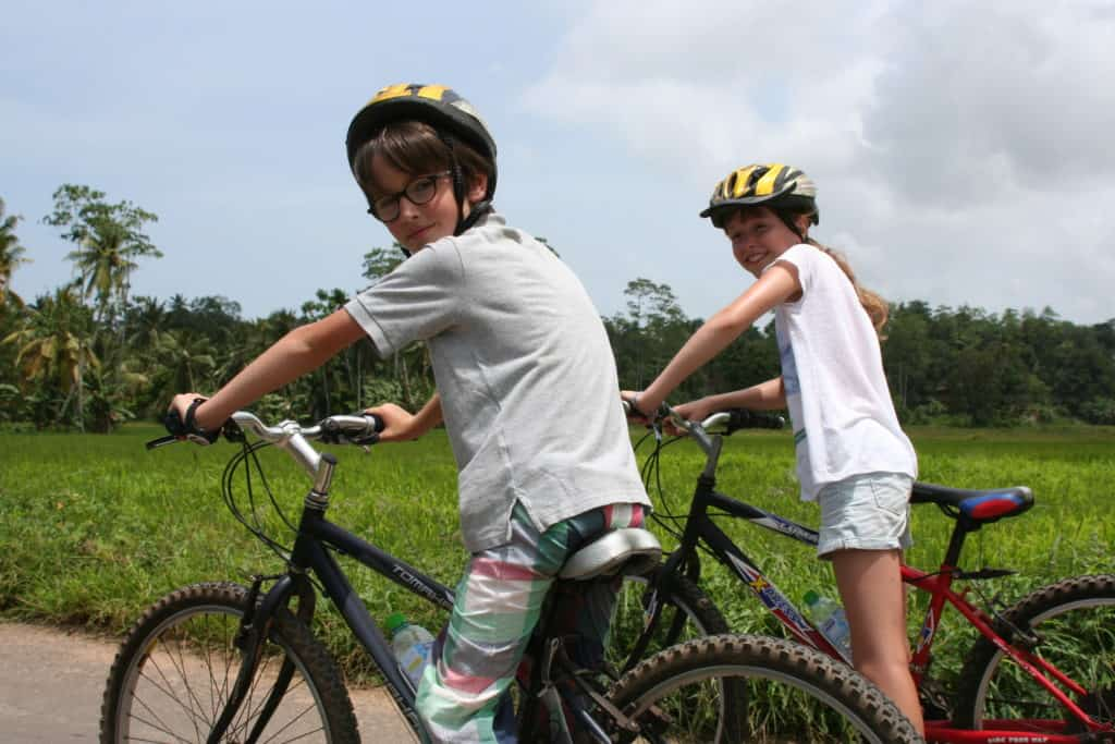 Children on bikes exploring the countryside of Gampaha