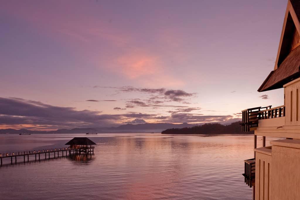 The jetty of Gaya Island Resort at sunset
