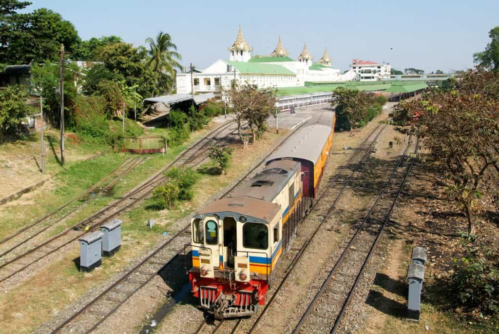 Yangon to Mandalay sleeper train departing a station