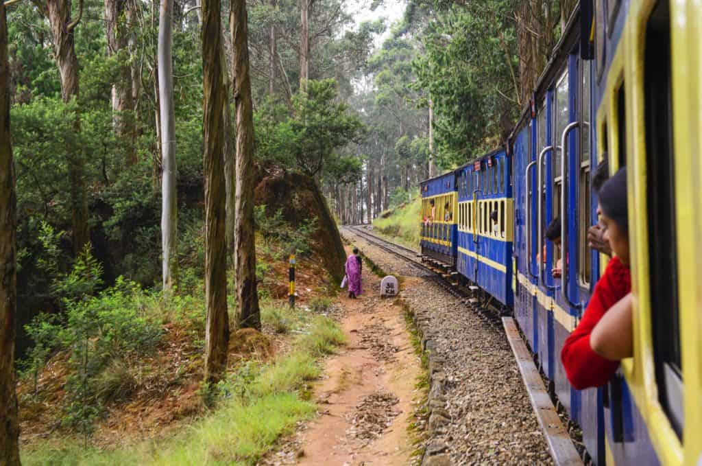 Nilgiri Mountain Railway line through snaking forests in the western ghats of South India