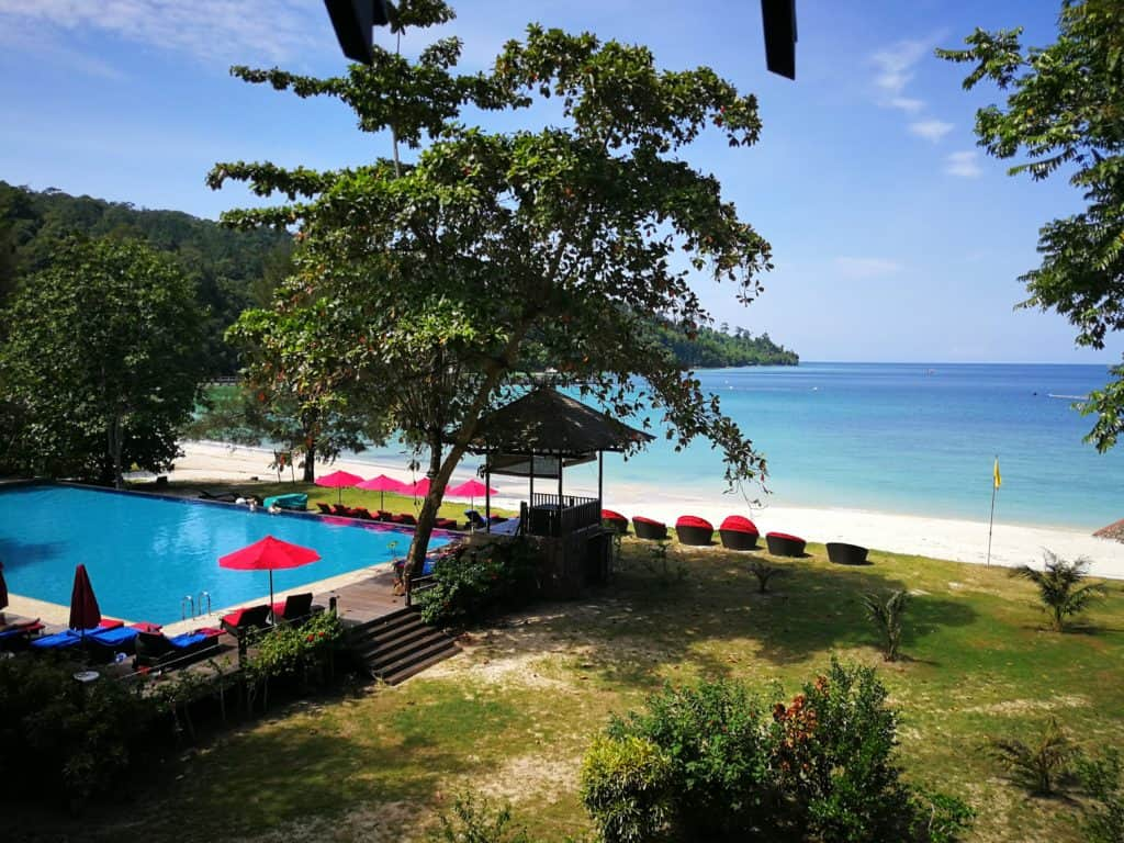 The private beach of Bunga Raya on Gaya Island Resort with pool in the foreground