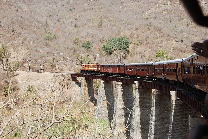 The 'monkey train' crossing a bridge in the Aravalli hills of Rajasthan