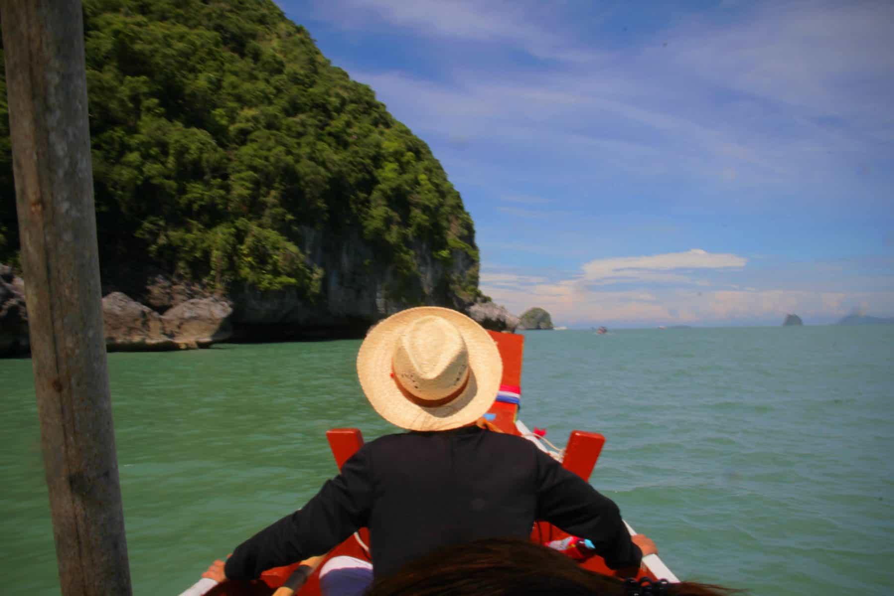 man sitting on a boat in Khanom in Thailand