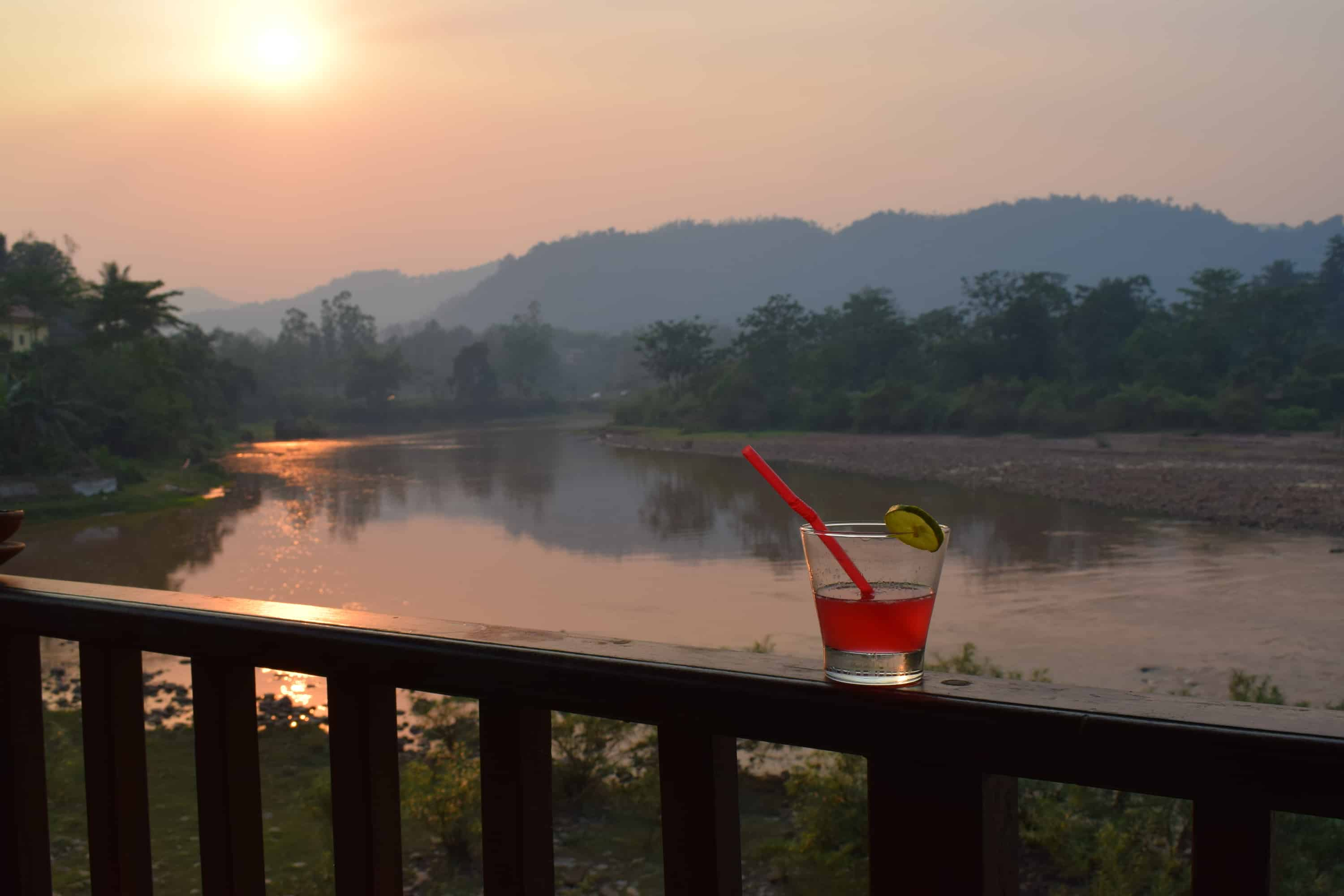 Cocktails on the terrace at Muang La Resort in Laos as the sunsets