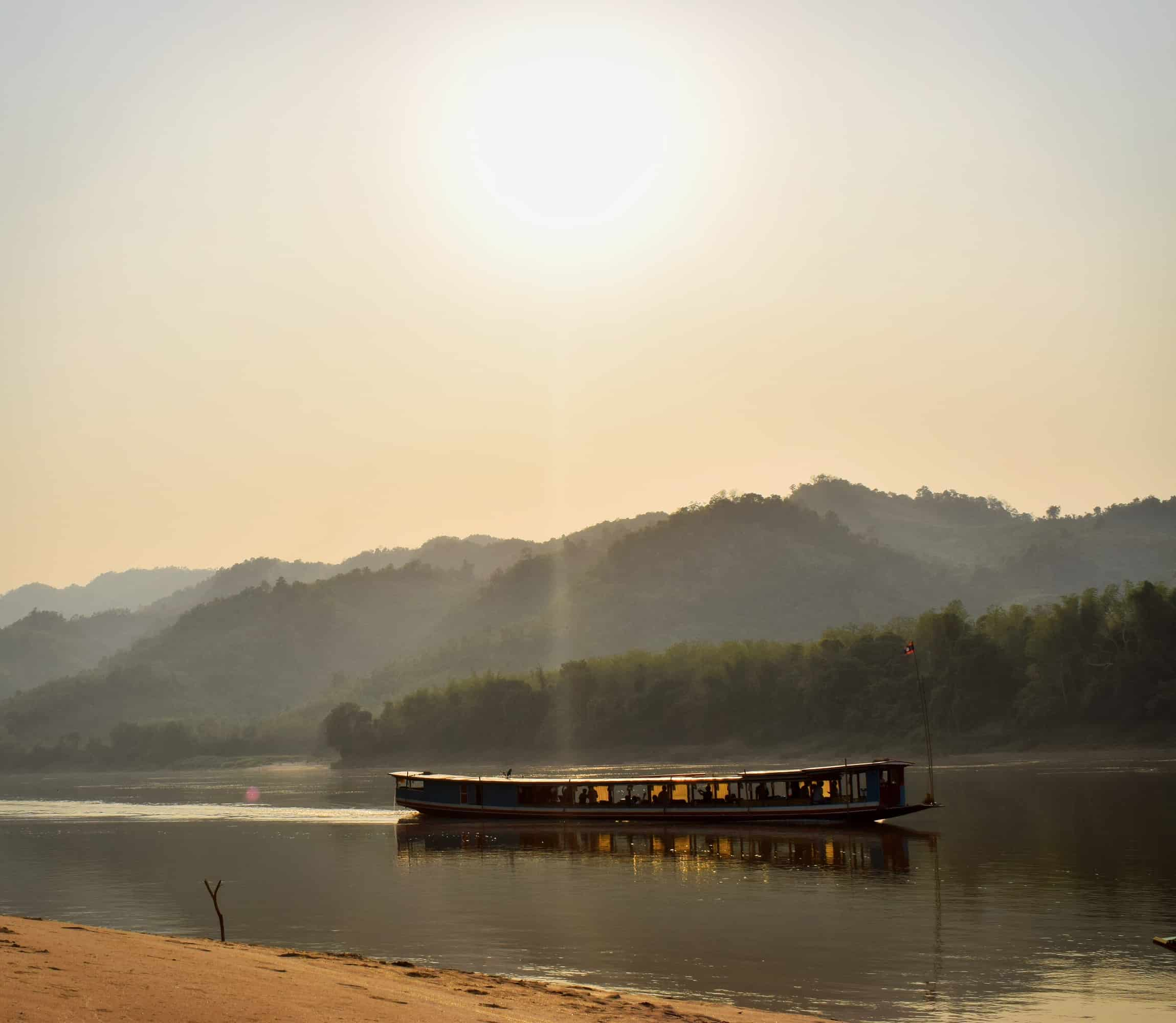 Sunset as a boat sails down the Mekong River in Laos