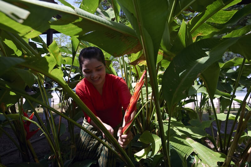 Staff member getting fresh ingredients from the vegetable plot at La Folie Lodge