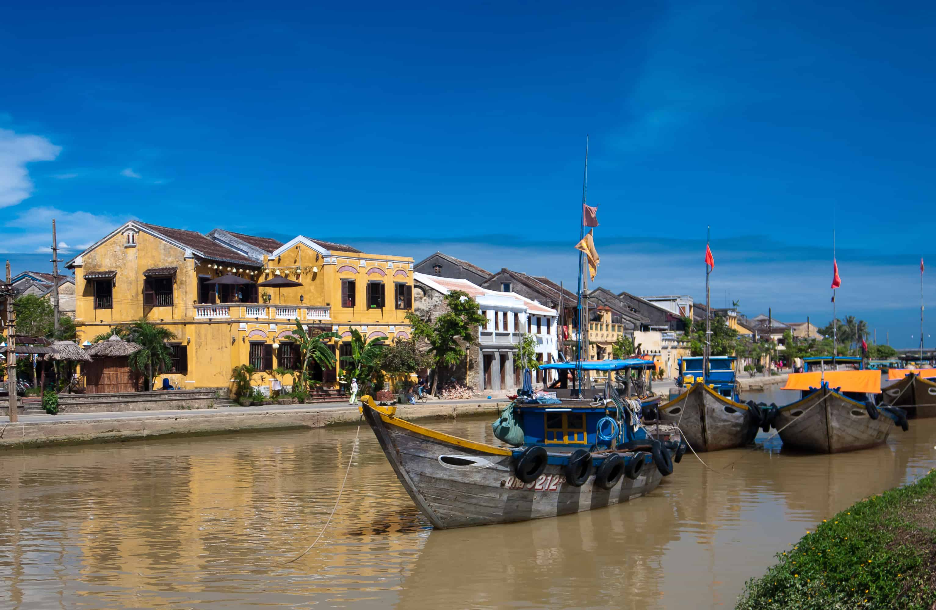 boats on the banks of Thu Bon River in Vietnam