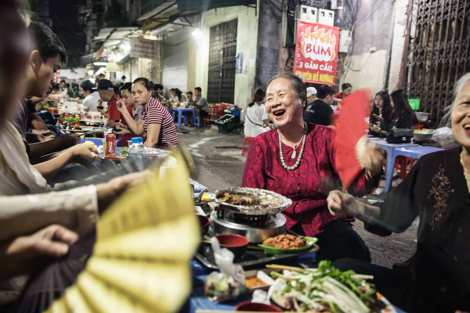 Evening Street food scene in Hanoi with locals