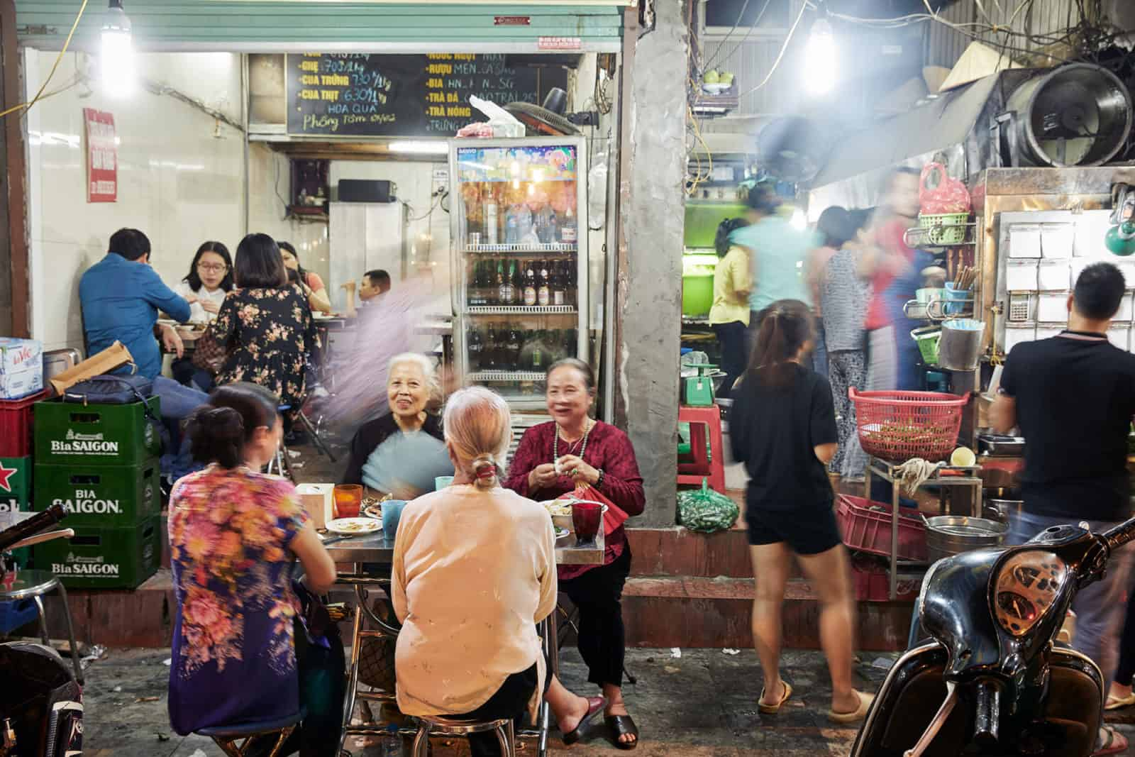 Locals sat outside a cafe in Hanoi in the evening