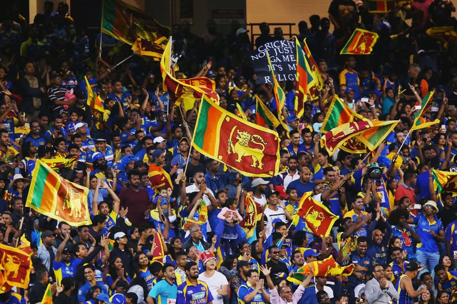 Sri Lankan cricket fans celebrating and waving flags