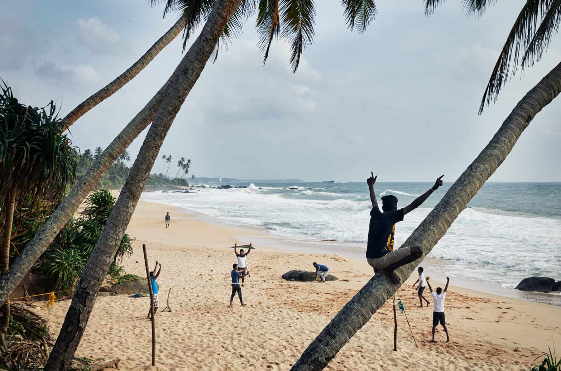 Locals having fun playing cricket on a Sri Lankan Beach