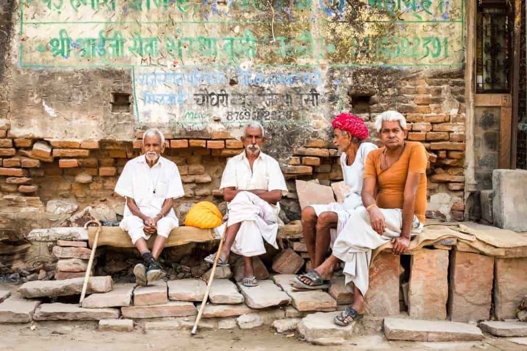 Four elderly gentlemen in a village in Rajasthan wearing traditional clothing
