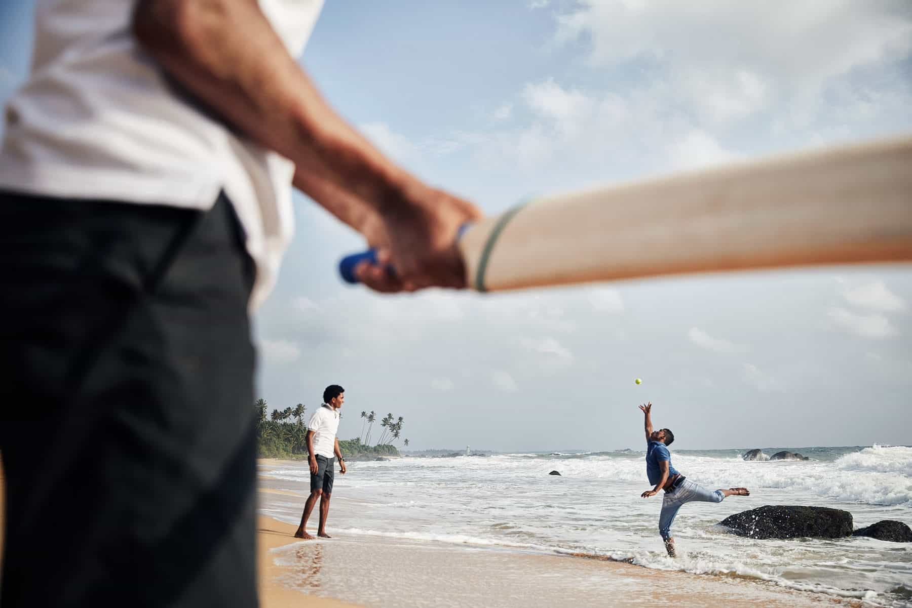 Cricket being played locals on a beach in Sri Lanka