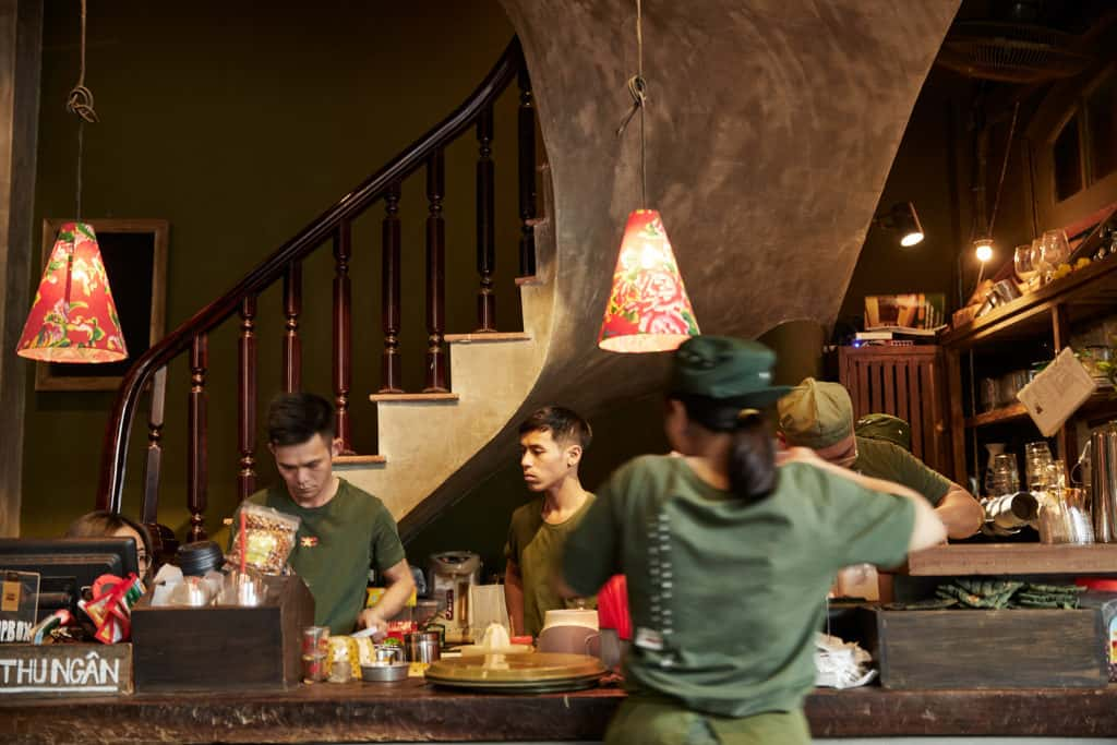 interior of a cafe in Ho Chi Minh city with a staircase in the background