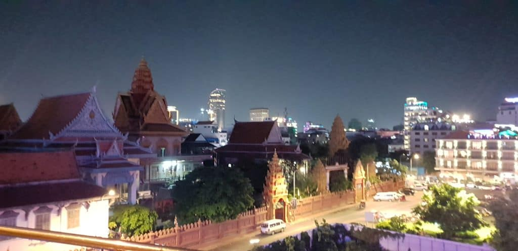 Contrasts of Phnom Penh: the city is starting to develop again after the recent devastation, and new buildings can be found with the traditional)