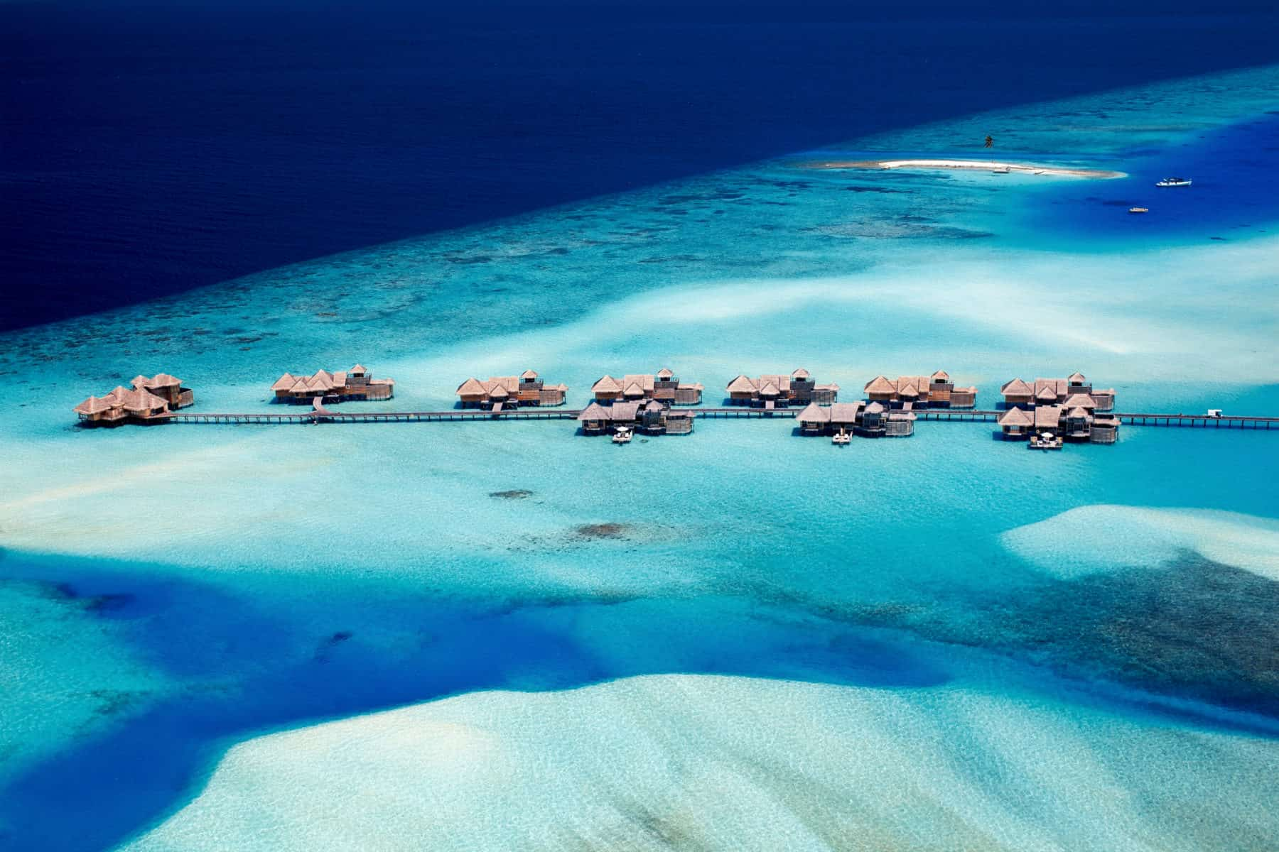 Aerial view of overwater villas and turquoise ocean in the Maldives