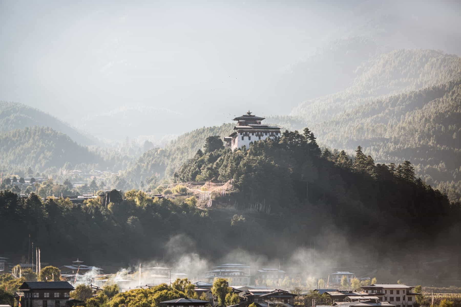 Bumthang Dzong at sunrise in Bhutan as the mist lifts