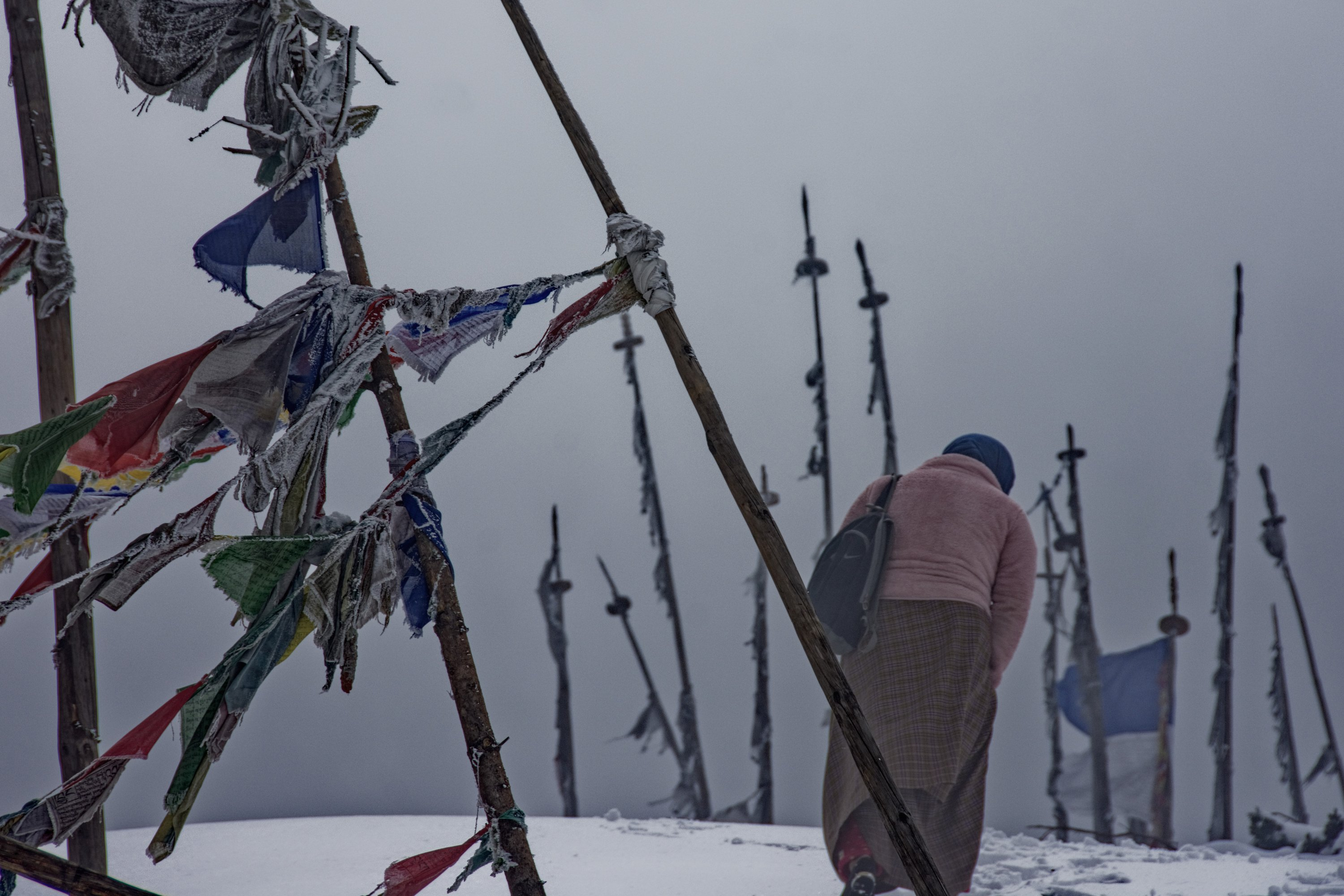 Snowy mountains and prayer flags in Bhutan