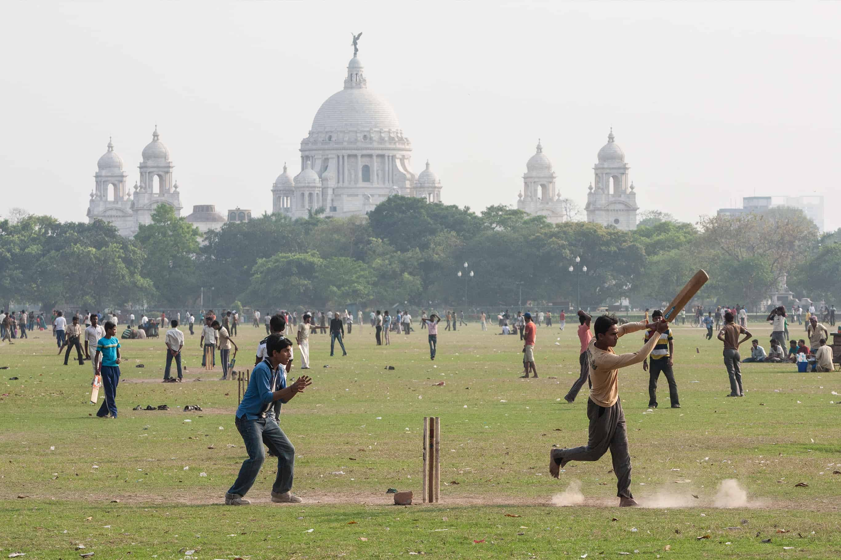 Playing cricket in Kolkata on the Maidan with the Victoria Memorial in the background