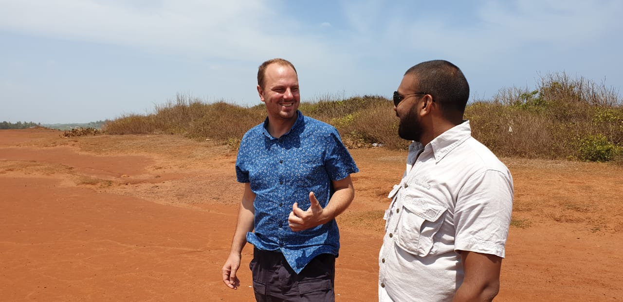 Traveller and guide exploring an arid landscape in Sri Lanka