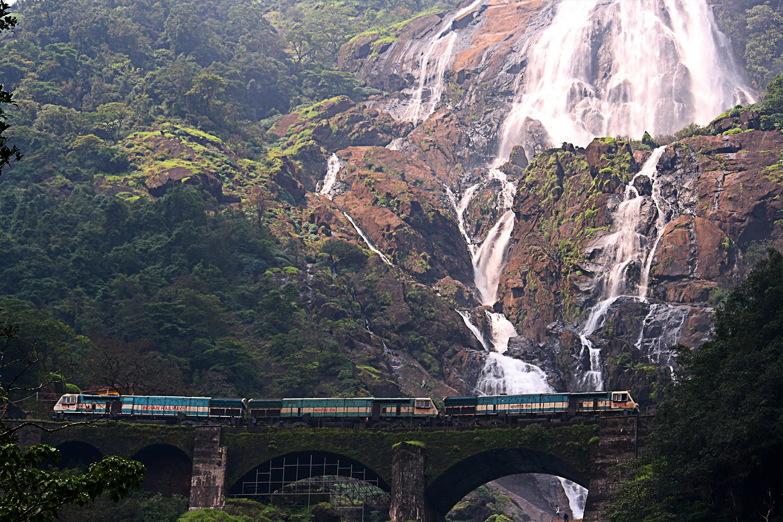 One of the best trains in India passing the Dudhsagar waterfall