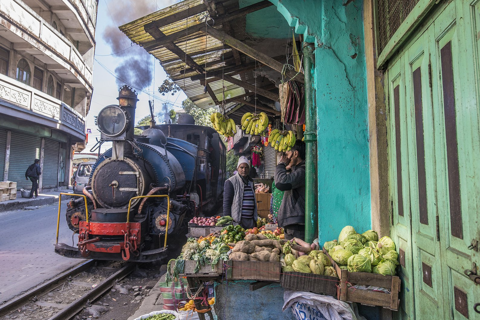 Toy train passing through a market in Darjeeling in India