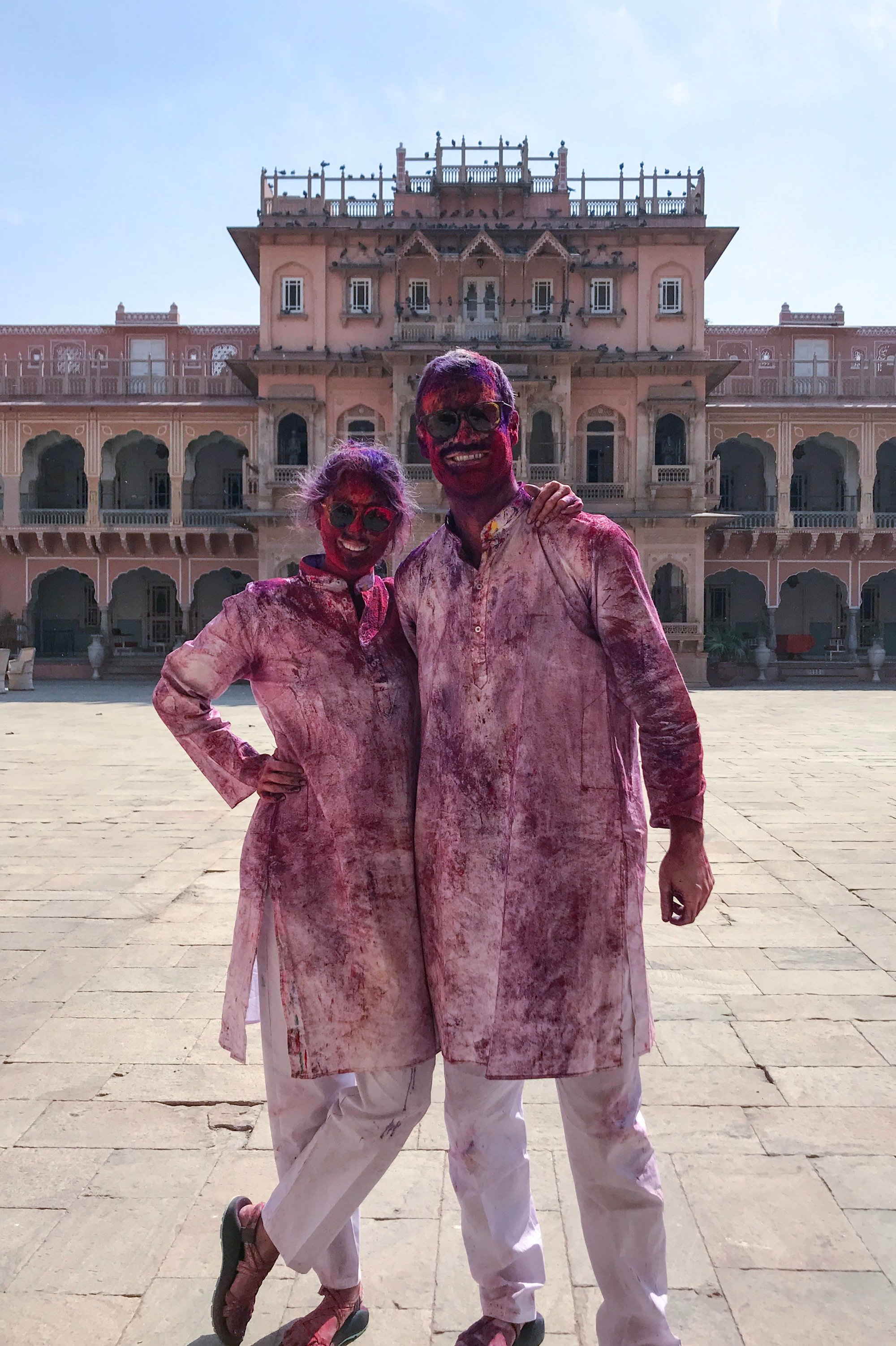 Tourist couple at Holi festival