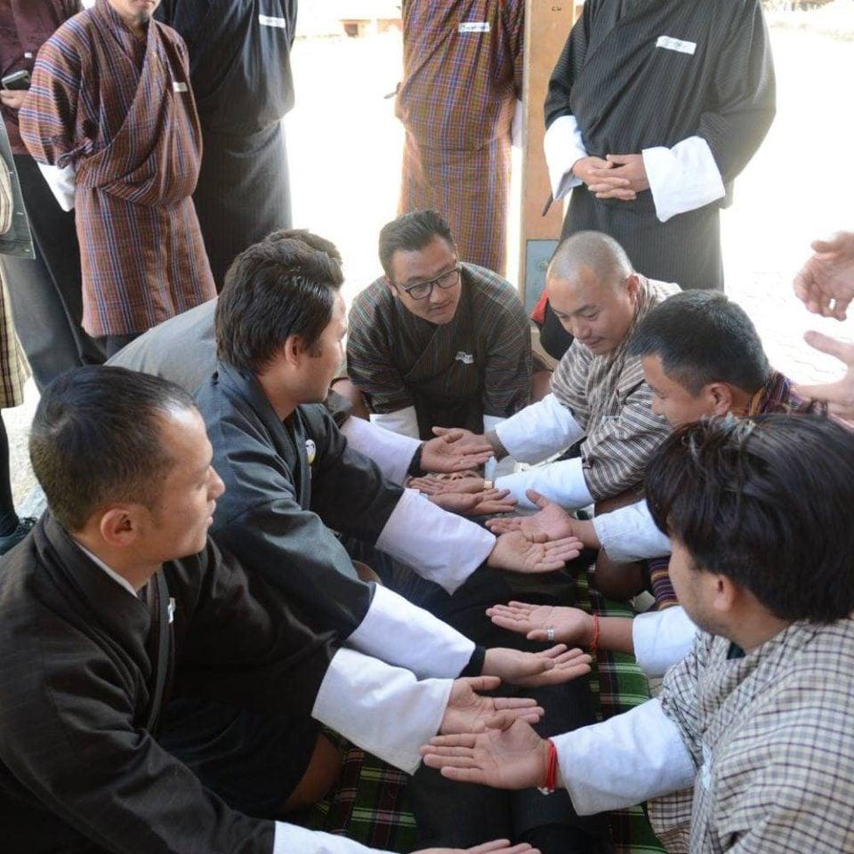 Men praying in Bhutan