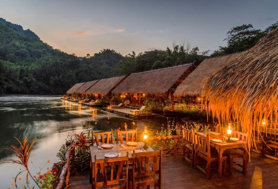 row of resort villas on the river kwai in thailand
