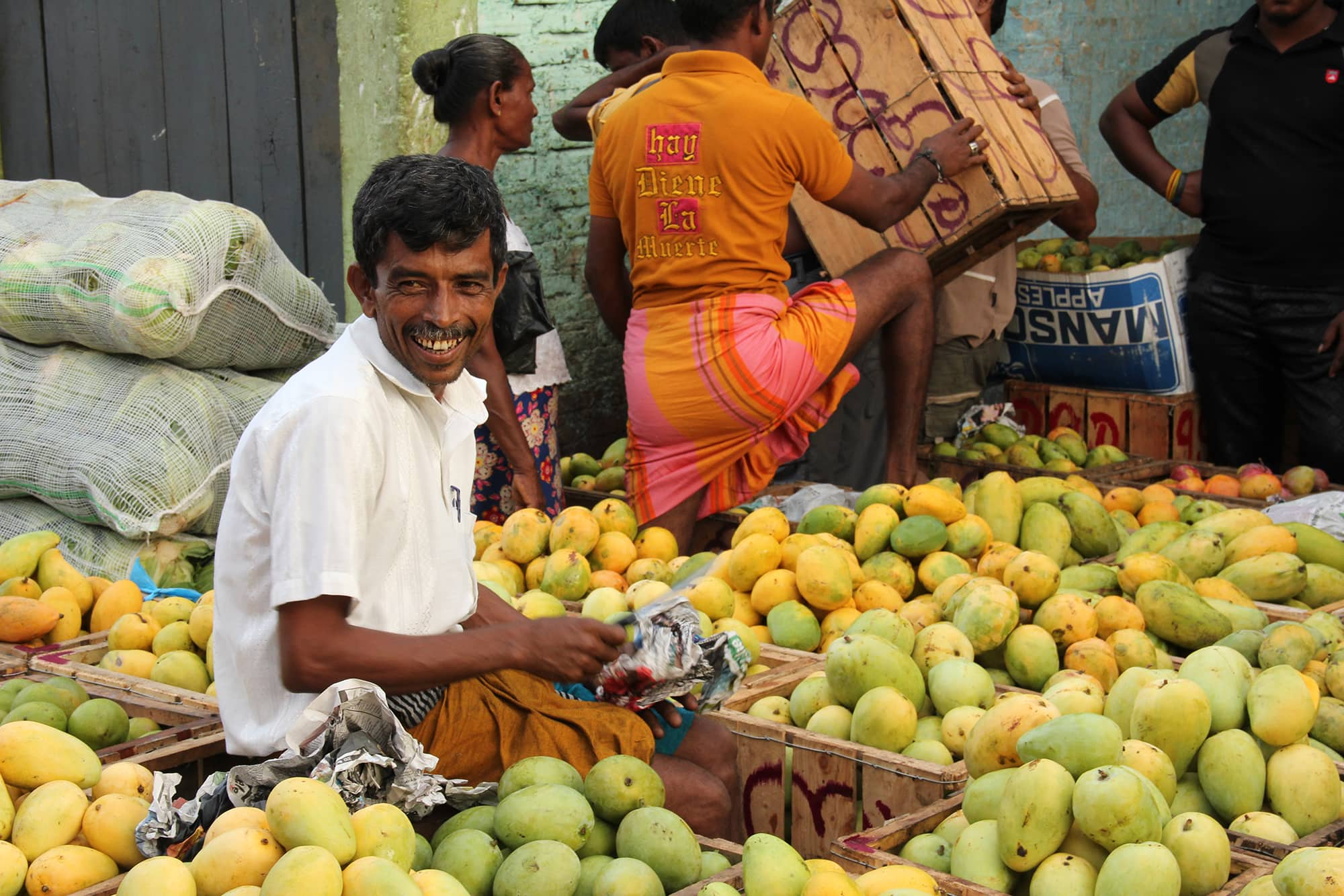 Mango trader in Sri Lanka with a smile on his face